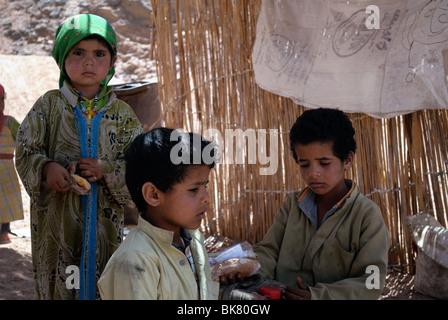 Portrait of children at a Bedouin village in desert near Hurghada, Egypt - Stock Photo