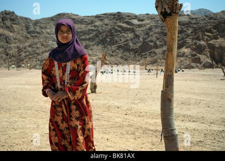 Portrait of  teenager girl at a Bedouin village in desert near Hurghada, Egypt - Stock Photo