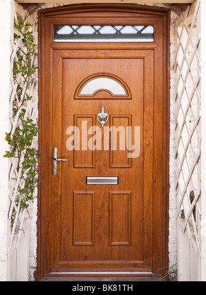 Front door with trellis work porch surround UK - Stock Photo