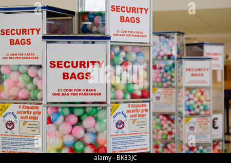 Vending machines dispensing security bags for liquids at an airport - Stock Photo