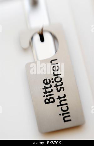 Door with a Do not disturb sign in German, Bitte nicht stoeren - Stock Photo