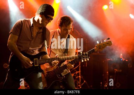 Guitarist Chris Muzik and bassist Géza Burghardt of the Swiss band, The Raveners, performing live in the Schueuer, - Stock Photo
