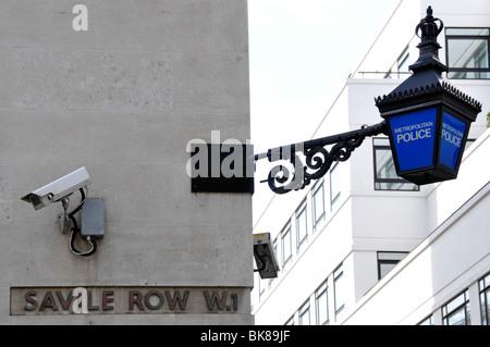CCTV camera mounted on wall of Savile Row police station - Stock Photo