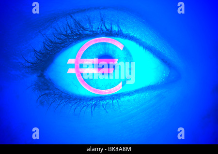 Close-up of an eye with the EURO symbol, symbolic picture for greed - Stock Photo