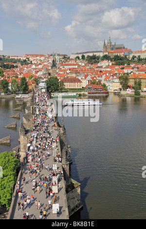 View from the Old Town Bridge Tower over the River Vltava, Charles Bridge with tourists, Prague Castle with St. - Stock Photo