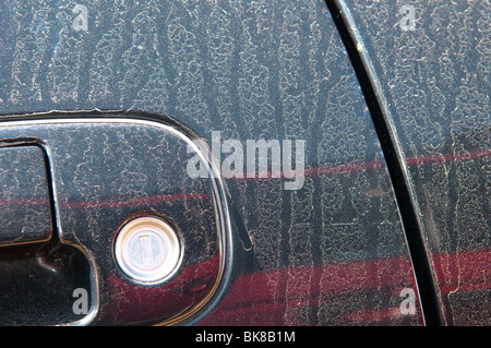 ash from erupting volcano in Iceland settled on car in England, April, 2010 - Stock Photo
