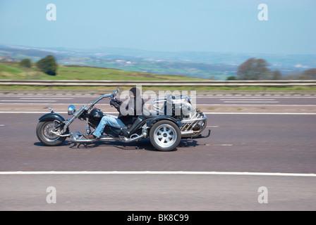 Biker on the M62 motorway (near Outlane, Huddersfield). - Stock Photo