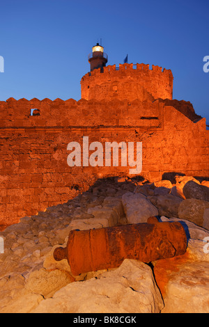 Rusty old cannon in front of the castle Ágios Nikólaos at the Mandraki harbour, Rhodes Town, Rhodes, Greece, Europe - Stock Photo