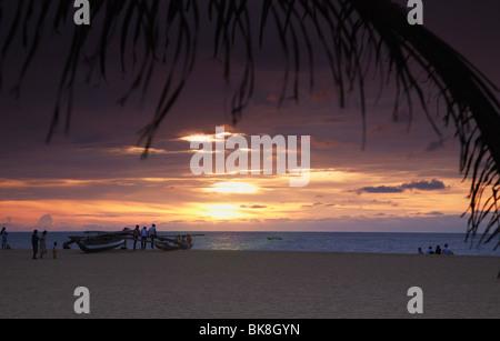 People on beach at sunset, Negombo, Sri Lanka - Stock Photo