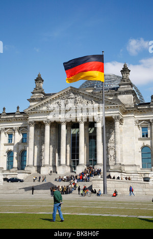 Flag on the Reichstag parliament in Berlin, Germany, Europe - Stock Photo