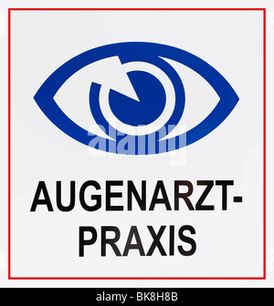 Sign: Augenarztpraxis, German for: eye specialist's surgery, with eye symbol - Stock Photo