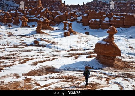 A tourist from Maryland - Idrissa Abdou - walks through Goblin Valley State Park in the San Rafael Swell area of - Stock Photo