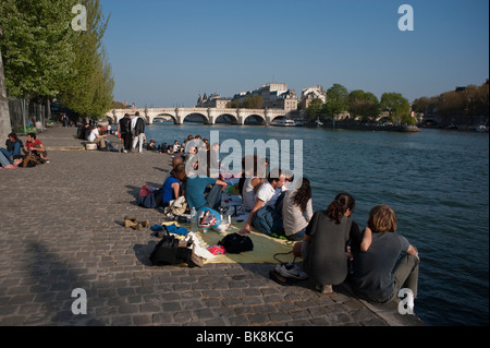 Paris, France, People Enjoying Spring Weather on Seine River Quay - Stock Photo