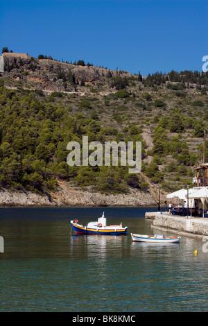 Assos harbour overlooked by Venetian castle, Kefalonia, Greece, Europe - Stock Photo