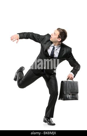 An afraid businessman running away - Stock Photo