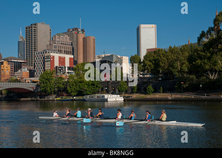 Rowing teams on the Yarra River in Melbourne, Victoria Australia - Stock Photo
