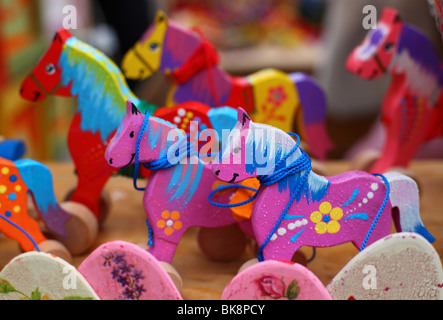 Colorful wooden horses and toys - Stock Photo