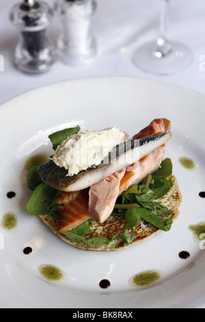 Trio of Smoked Fish on a Tarragon Blini with Horseradish Cream, Two Fat Ladies Restaurant, Glasgow, Scotland - Stock Photo