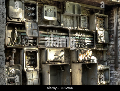 Switch boxes at the wall of an old factory, Berlin, Germany - Stock Photo