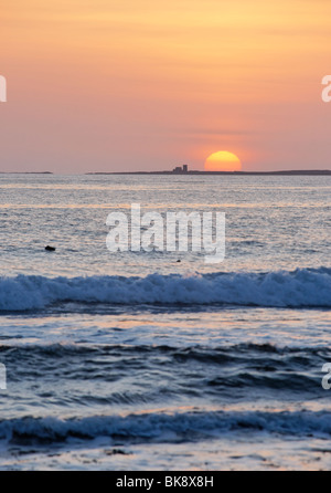 The Farne Islands at sunrise. Viewed from Bamburgh, Northumberland, England, UK. - Stock Photo