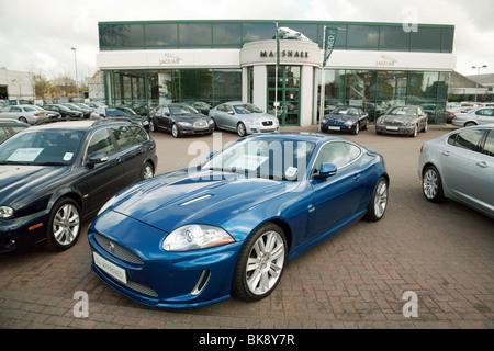 Jaguar car cars for sale outside Marshalls Jaguar dealership, Newmarket Rd, Cambridge, UK - Stock Photo