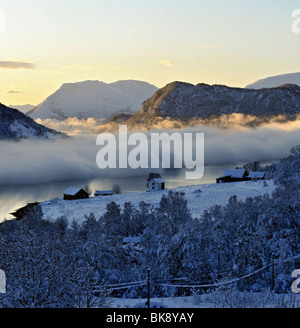 Fog, frost smoke, over a fjord in North Norway a cold winter day. - Stock Photo