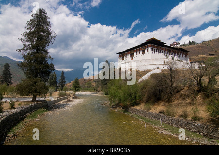 Monastery at the riverside, River Paro Chhu, Rinpung Dzong, Paro, Bhutan - Stock Photo