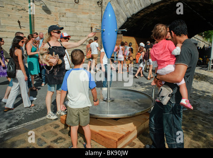 People Drinking Water, Paris Urban Beach Summer Festival, Paris Plages, Along River Seine plage - Stock Photo
