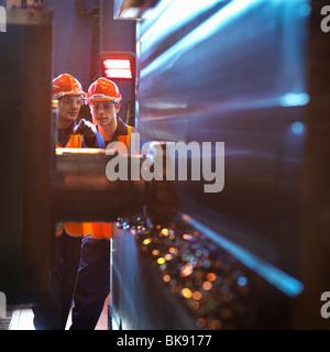 Engineer & Apprentice Using Cutting Tool - Stock Photo