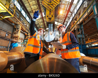 Engineer & Apprentice With Steel Rollers - Stock Photo