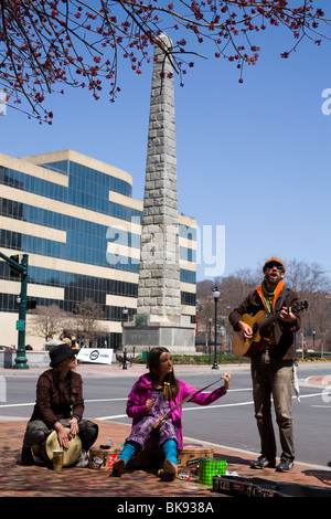 Street musicians playing on Pack Square in Asheville, North Carolina - Stock Photo