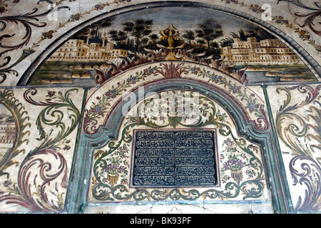 The walls of the Et'hem Bey mosque in Tirana's Skanderbeg Square are finely painted, inside and out - Stock Photo