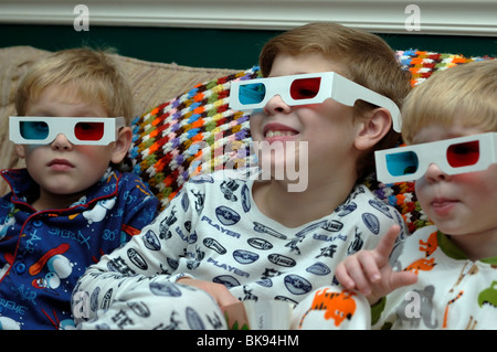 Young brothers wearing pajamas and 3-D glasses - Stock Photo