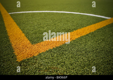 A close up of a corner section of a full size football or soccer pitch at an amateur club. - Stock Photo