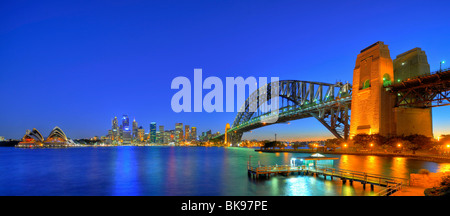 Panorama of the Sydney Opera House, Sydney Harbor Bridge, harbor, Sydney skyline, Central Business District, night, - Stock Photo