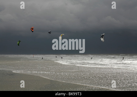 Kitesurfing during a storm on the North Sea, St. Peter Ording, Schleswig-Holstein, Germany, Europe - Stock Photo