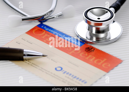 Organ donor card and stethoscope - Stock Photo