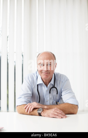 Doctor looking to camera - Stock Photo