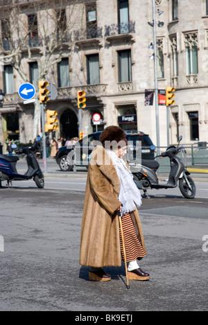 Local Spanish Senior woman wearing fur coat - Barcelona - Stock Photo