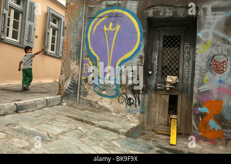 Street graffiti in Anafiotika quarter in Athens, Greece. - Stock Photo