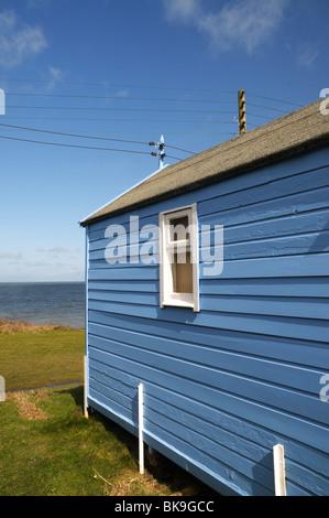 Blue beach hut at Westward Ho, Devon, UK - Stock Photo