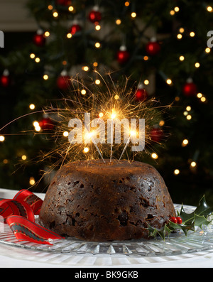christmas pudding with sparklers - Stock Photo