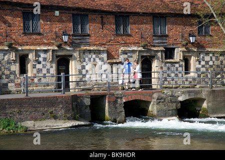 Children Walking Past, Mill House and Old Mill,  on Harnham Water Meadows, Salisbury, Wiltshire, England, UK, GB. - Stock Photo