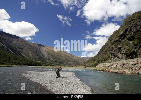Nelson guide Mike Kirkpatrick casts while fly fishing on the Upper Wairau River, Marlborough, New Zealand - Stock Photo