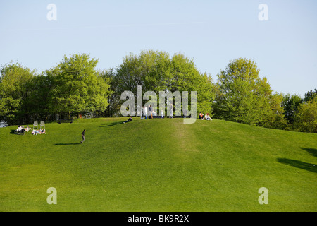 Meadow and hill in the Britzer Garten park in Berlin, Germany, Europe - Stock Photo