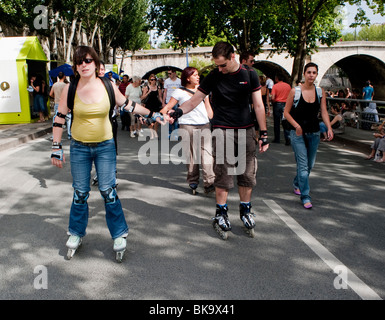 People Rollerblading, Paris Urban Summer Festival, Paris Plages, Along River Seine, adult extracurricular activities - Stock Photo
