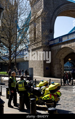 Two London Ambulance Service Motorcycle Response Units parked next to Twoer Bridge in London.  Photo by Gordon Scammell - Stock Photo