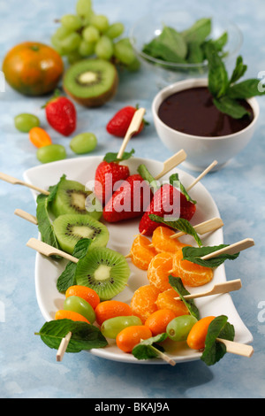Fruit skewers with chocolate and mint. Recipe available. - Stock Photo