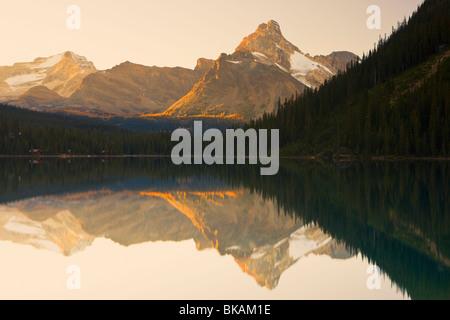 Reflection of a mountain in Lake O'Hara, Yoho National Park, British Columbia, Canada - Stock Photo
