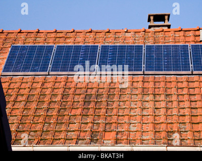 French solar panel / panels on the roof of a farm house in Alpine / Alps region of Savoy, France. - Stock Photo